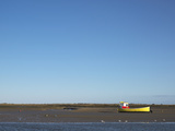 A Lone Boat at Low Tide at Brancaster Staithe, Norfolk, England Photographic Print by Jon Gibbs