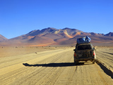 A 4x4 on the Southwest Circuit Tour, Rio Blanco, Bolivia, South America Photographic Print by Simon Montgomery