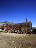 Rusting Old Steam Locomotive at the Train Cemetery (Train Graveyard), Uyuni, Southwest, Bolivia Photographic Print by Simon Montgomery