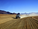 A 4x4 on the Southwest Circuit Tour, Bolivia, South America Photographic Print by Simon Montgomery