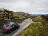 Car Driving Through Kirkstone Pass Mountain Road, Lake District National Park, Cumbria, England, UK Photographic Print by Ian Egner