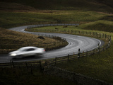 Silver Sports Car Driving Through Winding Road in Peak District National Park, Derbyshire, England Photographic Print by Ian Egner