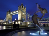 Girl with Dolphin by David Wynne, Illuminated at Night in Front of Tower Bridge, London, England Photographic Print by Peter Barritt