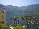 Pruned Plane Trees and Chapel of Villa Balbianello, in Spring Sunshine, Lenno, Lake Como, Italy Photographic Print by Peter Barritt
