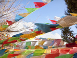 Prayer Flags Flying in Wind at Guishan Gongyuan Temple, Shangri-La (Zhongdian), China Photographic Print by Lynn Gail