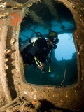 Diver Inside Wreck of Lesleen M Freighter, Sunk in 1985 in Anse Cochon Bay, St Lucia Photographic Print by Lisa Collins