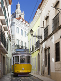 Tram (Electricos) Along Rua Das Escolas Gerais with Tower of Sao Vicente de Fora, Lisbon, Portugal Photographic Print by Stuart Black