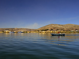 Rowing Boat, Islas Flotantes, Floating Islands, Lake Titicaca, Flotantes, Peru, South America Photographic Print by Simon Montgomery