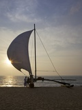 Fisherman and Oruvas (Traditional Outrigger Dug-Out Canoe), on Negombo Beach, Sri Lanka, Asia Photographic Print by Peter Barritt