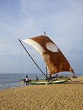 Fisherman and Oruvas (Traditional Outrigger Dug-Out Canoe), Negombo Beach, Sri Lanka Photographic Print by Peter Barritt