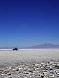 A 4x4 on Salar de Uyuni, the Largest Salt Flat in the World, South West Bolivia, Bolivia Photographic Print by Simon Montgomery