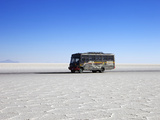Bus on Salar de Uyuni, the Largest Salt Flat in the World, South West Bolivia, South America Photographic Print by Simon Montgomery