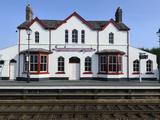 Station Building at Llanfairpwllgwyngyllgogerychwyrndrobwllllantysiliogogogoch, Wales, UK Photographic Print by Chris Hepburn