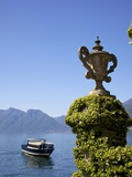 Passenger Boat in Spring Sunshine Off Villa Balbianello, Lenno, Lake Como, Lombardy, Northern Italy Photographic Print by Peter Barritt