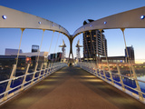Dawn View across the Millennium Bridge, Salford Quays, Manchester, Greater Manchester, England, UK Photographic Print by Chris Hepburn