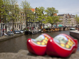 Souvenir Clogs and Canal, Amsterdam, Holland, Europe Photographic Print by Frank Fell