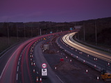 Roadworks, Lane Closures and Speed Limits on M5 Motorway at Dusk, Near Birmingham, England Photographic Print by Ian Egner