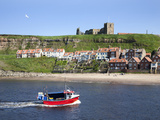 Fishing Boat Entering the Harbour Below Whitby Abbey, Whitby, North Yorkshire, Yorkshire, England Photographic Print by Mark Sunderland