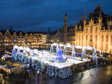 Ice Rink and Christmas Market in the Market Square, Bruges, West Vlaanderen (Flanders), Belgium Photographic Print by Stuart Black