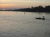 Traditional Rowing Boat on the River at Sunset, Pathein, Irrawaddy Delta, Myamar (Burma), Asia Photographic Print by Eitan Simanor