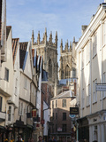 Towers of the Minster from Petergate, York, Yorkshire, England, United Kingdom, Europe Photographic Print by Mark Sunderland