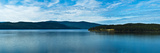 Lake with Mountain Range in the Background, Lake Pend Oreille, Idaho, USA Photographic Print by  Panoramic Images