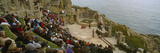 Spectators Watching Play in an Open-Air Theatre, Minack Theatre, Porthcurno, Cornwall, England Photographic Print by  Panoramic Images