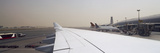 Airplanes at an Airport, Dubai International Airport, Dubai, United Arab Emirates Photographic Print by  Panoramic Images