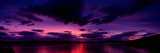Sunset over an Island Viewed from Applecross Peninsula, Isle of Skye, Inner Hebrides, Hebrides, ... Photographic Print by  Panoramic Images