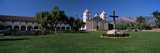 Cross with a Church in the Background, Mission Santa Barbara, Santa Barbara, California, USA Photographic Print by  Panoramic Images