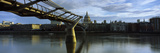 Bridge across a River with a Cathedral in the Background, London Millennium Footbridge, St. Paul... Photographic Print by  Panoramic Images