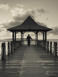 Silhouette of a Person on a Pier at Dawn, Mahebourg, Mauritius Photographic Print by Green Light Collection