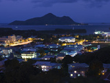 Cityscape Lit Up at Dusk Viewed from Beau Vallon Road, Victoria, Mahe Island, Seychelles Photographic Print by  Green Light Collection