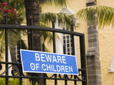 Beware of Children Sign on a Gate, Notre Dame Des Anges Church, Mahebourg, Mauritius Photographie par  Green Light Collection