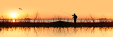 Silhouette of a Man Fishing Photographic Print by  Panoramic Images