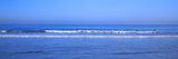 Surfers Riding a Wave in the Sea, Santa Monica, Los Angeles County, California, USA Photographic Print by Panoramic Images