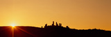 Silhouette of a Town on a Hill at Sunset, San Gimignano, Tuscany, Italy Photographic Print by  Panoramic Images