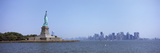 Statue of Liberty with Manhattan Skyline in the Background, Liberty Island, New York City, New Y... Photographic Print by  Panoramic Images