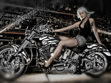 Female Model with a Motorcycle in a Workshop Photographic Print by  Panoramic Images