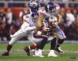 Kawika Mitchell SB XLII Tackling Stallworth Photo