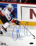 Adrian Aucoin with Puck Autographed Photo (Hand Signed Collectable) Photo