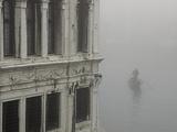 A Gondola Glides Through a Canal in Fog Fotografisk tryk af Kike Calvo