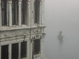 A Gondola Glides Through a Canal in Fog Photographic Print by Kike Calvo
