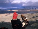 A Kazakh Eagle Hunter with His Bird in the Winter Fotografisk tryk af David Edwards