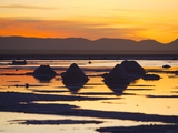 Mounds of Salt and Sunrise Reflecting Off Water in the Salt Flats Photographic Print by Mike Theiss