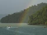 A Rainbow Arches over the Shoreline Near the Esquinas River Photographic Print by Michael Melford