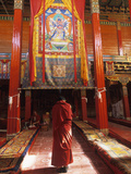 A Male Monk Offers Prayers in Batang Monastery Photographic Print by David Edwards
