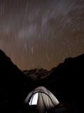 A Long Exposure Reveals the Earth Rotation Above Tents at Jhangothang Photographic Print by Alex Treadway