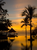 Sunset Scene with Infinity Pool and Trees Overlooking the Java Sea Photographic Print by Paul Sutherland