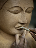 A Man Sculps a Buddha from Clay Which Will Eventually Be Bronzed Photographic Print by Alex Treadway
